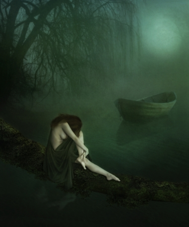 Lonely Girl in the night sitting in a tree above the water Stock Photo - 16212708