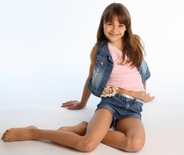 Beautiful Girl In A Denim Shorts Is Resting On The Floor Barefoot Elegant Attractive Child