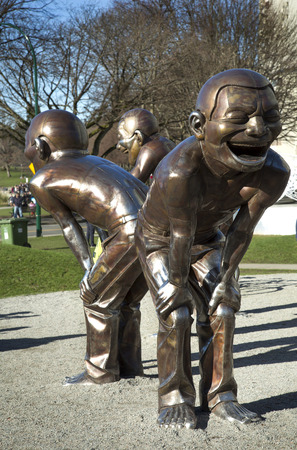 fun laughter humor funny: VANCOUVER-CANADA, 8 February 2016: Yue Minjun is part of Cynical Realism, Chinese artistic movement in response to 1989 demonstrations in Tiananmen. The bronze characters depict the artists own face Editorial