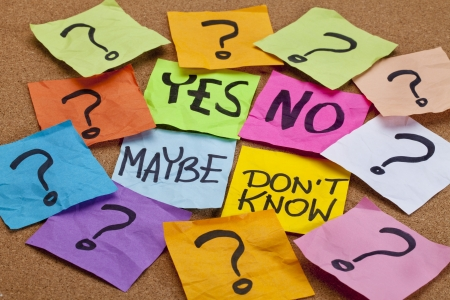 yes, no, maybe, I do not know - choice or uncertainty concept - colorful sticky notes on a cork bulletin board Stock Photo - 10299826