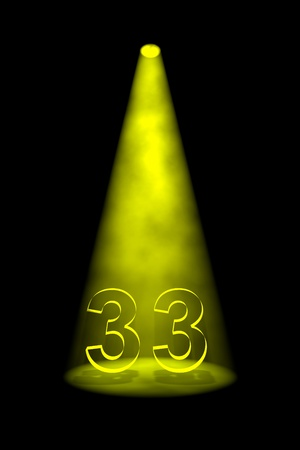 numbers 33 SPOTLIGHT: Number 33 illuminated with yellow spotlight on black background Stock Photo