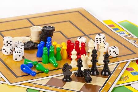 Details of several colorful board games and game pieces. Stock Photo - 9712039