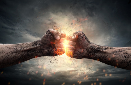 war: Fight, close up of two fists hitting each other over dramatic sky