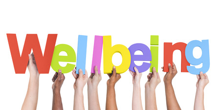 Diverse Hands Holding The Word Wellbeing Stock Photo - 28863045