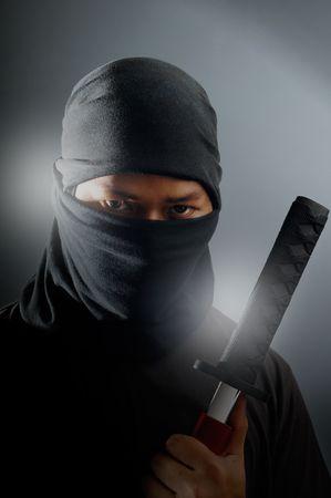 ninja: Ninja holding samurai sword.