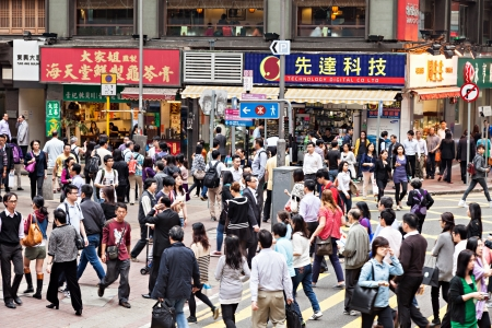 HONG KONG - MARCH 19: Unidentified people near Wan Chai metro station on March, 19, 2013. Wan Chai metro station is a one of the most busy in HK. Stock Photo - 22053600