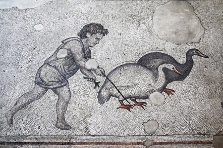 Ancient roman mosaic from the Great Palace of Constantinople depicting a boy herding geese. Stock Photo - 55057895
