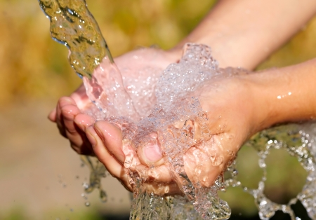 Woman's hands with water splash Stock Photo - 15077555
