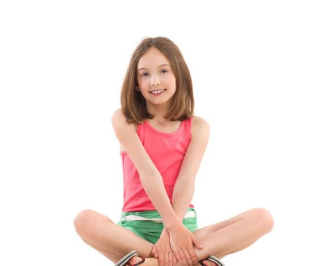 Smiling Young Girl Posing Wth Legs Crossed Full Length Studio Shot Isolated On White