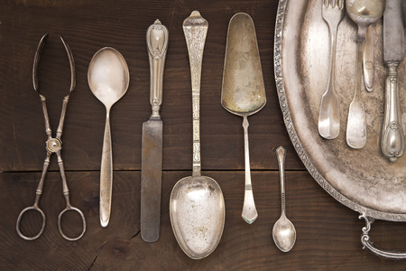 silver CUTLERY: Vintage silver cutlery on a wooden background
