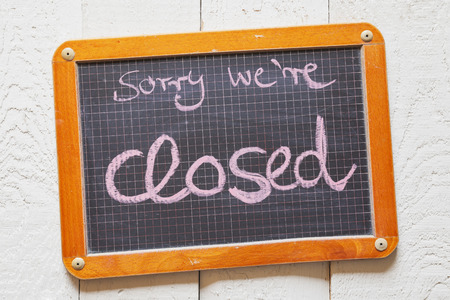 Vintage blackboard with Sorry we're closed text Stock Photo - 39191752