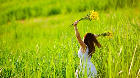 woman in white dress triwls in field with flowers in hand. summer carefree girl Stock Photo - 8726281