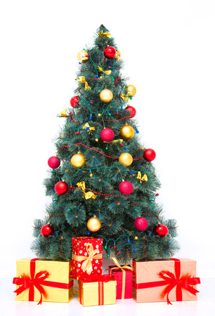 Traditional Christmas tree with baubles and gifts on white Stock Photo - 23482412