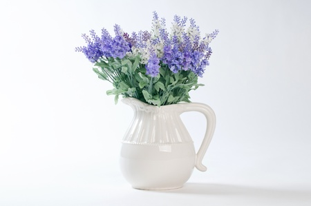 wild flowers in a white vase on a white background  Stock Photo - 19117804
