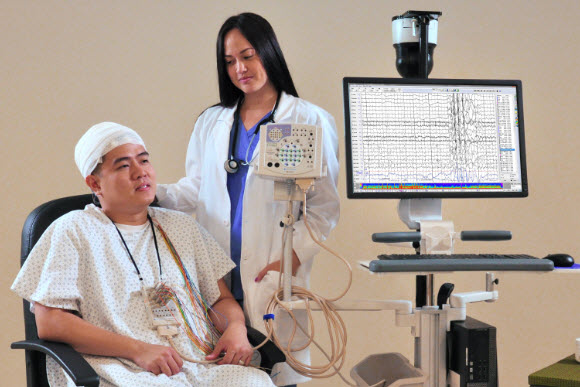 patient receiving an EEG to measure their epilepsy, which can be impacted by genetics and helped with cannabis