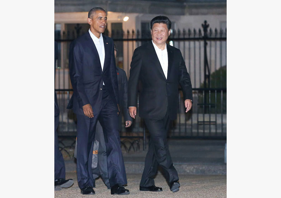 Xi, Obama go tieless to untie various issues at private dinner
