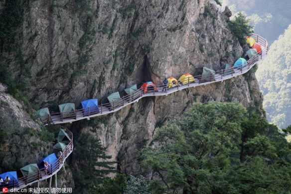 Campers sleep perched on cliff face