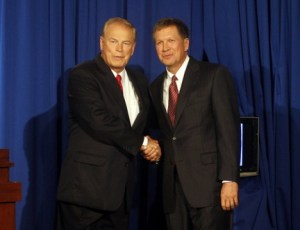 Strickland, left, and Kasich share an awkward handshake before a debate. Image: ##http://www.cleveland.com/open/index.ssf/2010/09/ohio_gov_ted_strickland_and_ch.html##Columbus Dispatch##