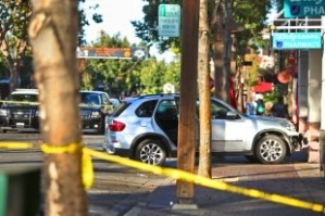 """Collision scene: In October a 90-year-old driver struck three boys walking on the sidewalk in Menlo Park, California. Now the driver claims the boys were behaving """"recklessly."""" Image: ##http://www.paloaltoonline.com/news/2013/12/31/driver-responds-to-lawsuit-over-menlo-park-crash-that-injured-6-year-old-twins## Palo Alto Online##"""