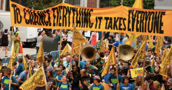 A protesters gathered in New York City to demand action on climate, a new report shows exactly what that action could offer us. Photo: South Bend Voice via Flickr