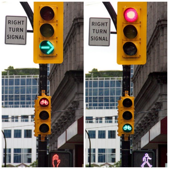 Separate right turn signals for cars, bikes and pedestrians on Vancouver's Hornby Street bike lane. Photo: ##http://theprudentcyclist.com/2012/06/lessons-from-vancouvers-hornby-street-cycle-track/##The Prudent Cyclist##