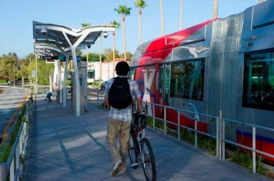 San Bernardino's new sbX light rail service has platform level boarding and interior bike racks. It's also led to a walkable TOD revolution that won the Streetsie for Best Street Transformation of 2014. Photo courtesy of Matt Korner