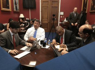 House Transportation and Infrastructure Committee Chair Bill Shuster (center, in white) and U.S. Transportation Secretary Anthony Foxx (right, in the red tie) held a Twitter town hall to promote a long-term transportation funding plan. Photo: Bill Shuster via Twitter