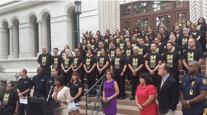 Fifty-four people stood on the steps of San Antonio's City Hall, one for each pedestrian killed on city streets in the past year. The demonstration marked the start of the city's Vision Zero effort, aimed at entirely eliminating traffic deaths. Photo: San Antonio Fire Department
