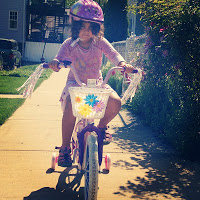 A photo of the writer's daughter, learning to bike and wear a helmet. Image: ##http://www.mybikeadvocate.com/2013/12/oak-park-wrong-to-mandate-that-children.html## Chicago Bicycle Advocate##