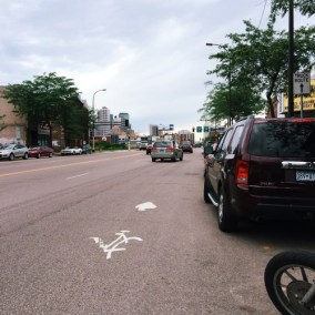 This faded bike lane sits right outside the Minneapolis Bike Coalition's office. Photo: Streets.mn