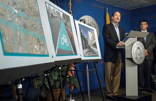 This doctored photo shows Albuquerque Mayor Richard Berry announcing a new network of buffered bike lanes. That actually never happened. Image: Urban ABQ