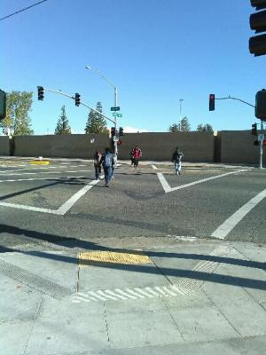 Fresno State University is trying to transition from a drive-to campus to one with a more balanced menu of transportation options. This pedestrian scramble is designed to reduce pedestrian injuries. Photo: Stop and Move