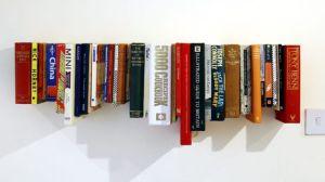 Books on hanging shelf.designblog