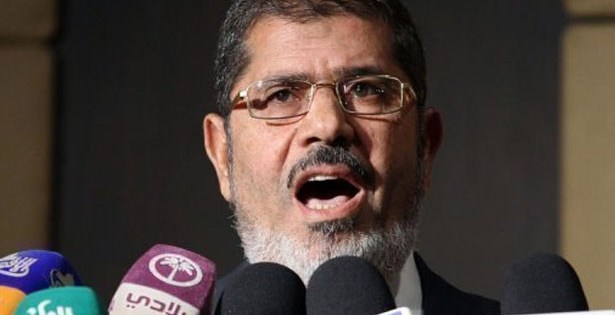 SHOWDOWN: Deposed Egyptian president Morsi of Muslim Brotherhood on trial; Death penalty, life sentence possible