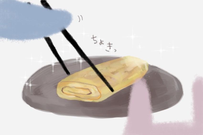 (お父さんが卵を箸で切り分けている。)
