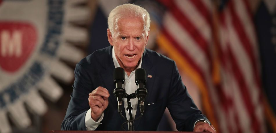 Joe Biden speaks at the podium on stage during a rally for Senator Claire McCaskill on October 31, 2018.