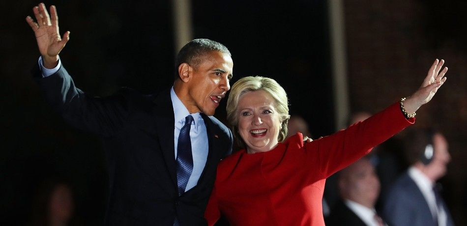 Barack Obama appears with Hillary Clinton at a campaign rally.