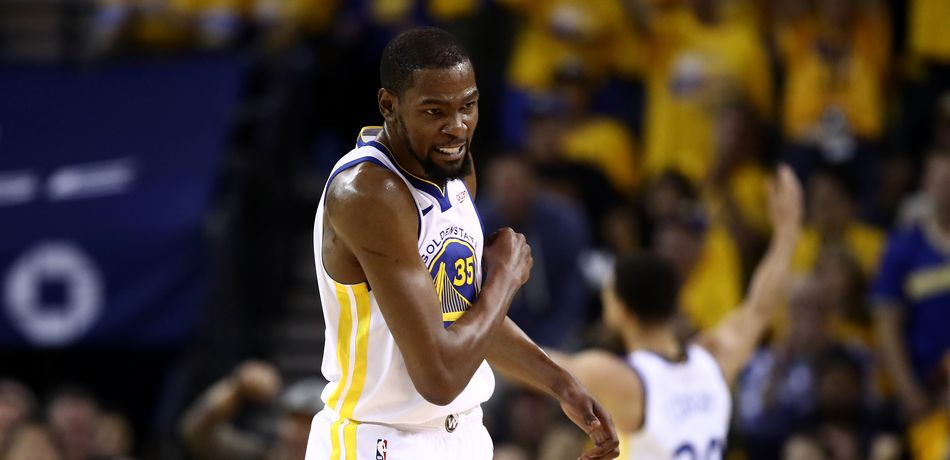 Kevin Durant #35 of the Golden State Warriors reacts after the Warriors scored a basket against the Houston Rockets during Game Five of the Western Conference Semifinals of the 2019 NBA Playoffs at ORACLE Arena on May 08, 2019 in Oakland, California.