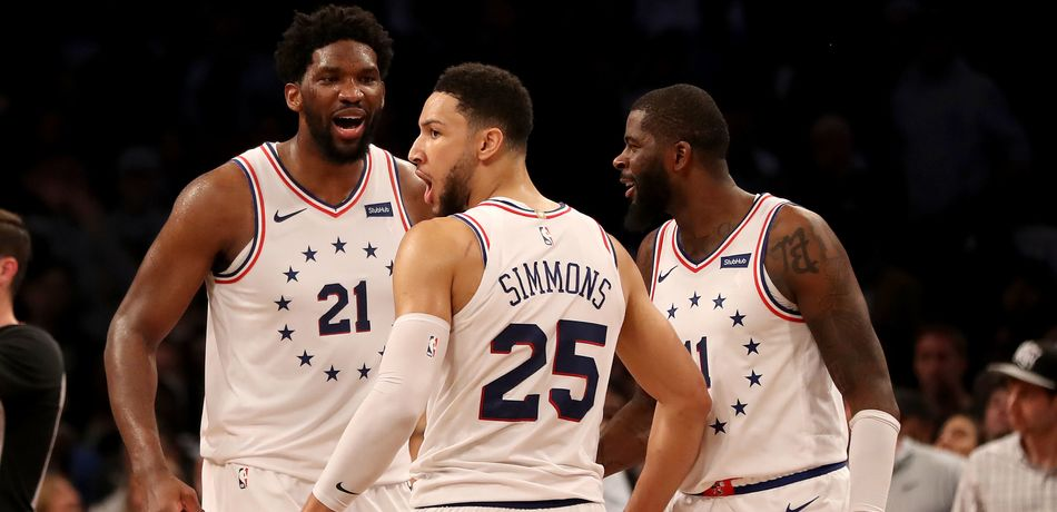 Joel Embiid #21,Ben Simmons #25 and James Ennis III #11 celebrate late in the fourth quarter against the Brooklyn Nets at Barclays Center on April 20, 2019 in the Brooklyn borough of New York City.