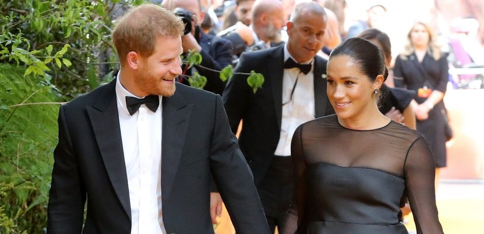 Meghan Markle and Prince Harry appear at a movie premiere.