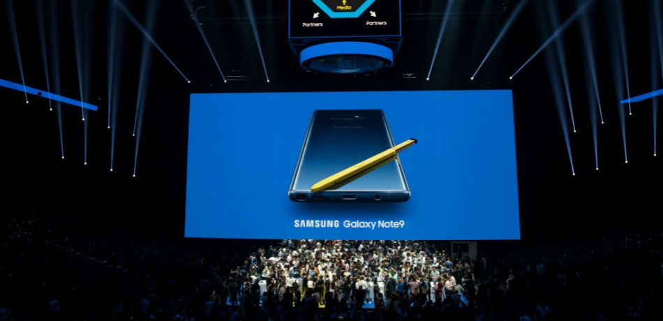 The Samsung Galaxy Note 9 is displayed in front of an audience during its 2018 launch event.