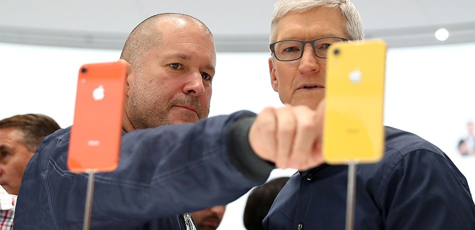 Apple chief design officer Jony Ive (L) and Apple CEO Tim Cook inspect the new iPhone XR during an Apple special event at the Steve Jobs Theatre on September 12, 2018 in Cupertino, California.
