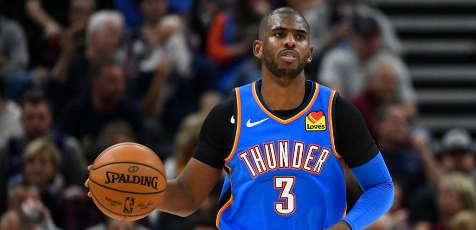 Chris Paul of the Oklahoma City Thunder dribbles the ball during a game against the Utah Jazz.