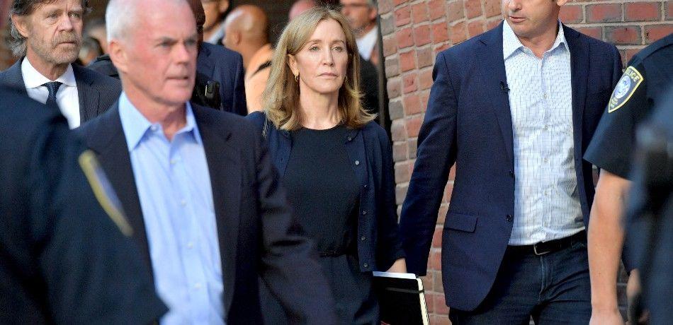 Felicity Huffman appears outside a court house.