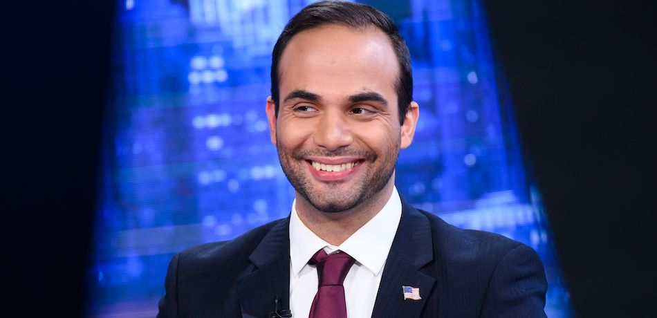 Former Donald Trump campaign manager George Papadopoulos smiles.