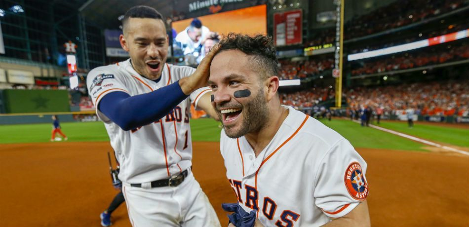 Jose Altuve #27 of the Houston Astros is congratulated by his teammate Carlos Correa #1 following his ninth inning walk-off two-run home run to defeat the New York Yankees 6-4 in game six of the American League Championship Series at Minute Maid Park on October 19, 2019 in Houston, Texas. The Astros defeated the Yankees 6-4.