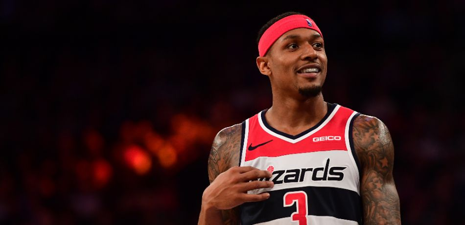 Bradley Beal #3 of the Washington Wizards smiles during a timeout during the fourth quarter of the game against New York Knicks at Madison Square Garden on December 03, 2018 in New York City.