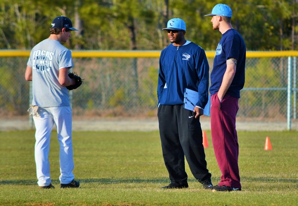 "Former Cougars Jamel Paige and Mark Blankenship, shown giving advice to current player Lucas Bell, have returned ""home"" and will be volunteering as assistants this season. Photo by Cindy Crosby"