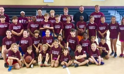 Basketball camp participants dressed in their camp t-shirts.