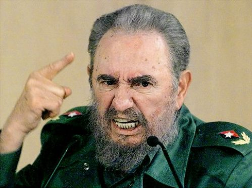 """(FILES) In this 04 September1999 file photo, Cuban President Fidel Castro discusses his request to the president of the International Olympic Committee in Havana for an investigation into the treatment of certain Cuban atheletes. Castro said the communist nation is not afraid of dialogue with the United States -- and not interested in continued confrontation with its powerful neighbor. The comments came as a group of US lawmakers visited Cuba this weekend to try to end nearly half a century of mutual distrust and amid reports that President Barack Obama was planning to ease economic sanctions on the island, including travel restrictions on Cuban-Americans. """"We're not afraid to talk with the United States. We also don't need confrontation to exist, like some fools like to think,"""" Castro, 82, said in an article on the Cubadebate website on April 5, 2009. AFP PHOTO/ADALBERTO ROQUE /FILES (Photo credit should read ADALBERTO ROQUE/AFP/Getty Images) Original Filename: Was672139.jpg"""